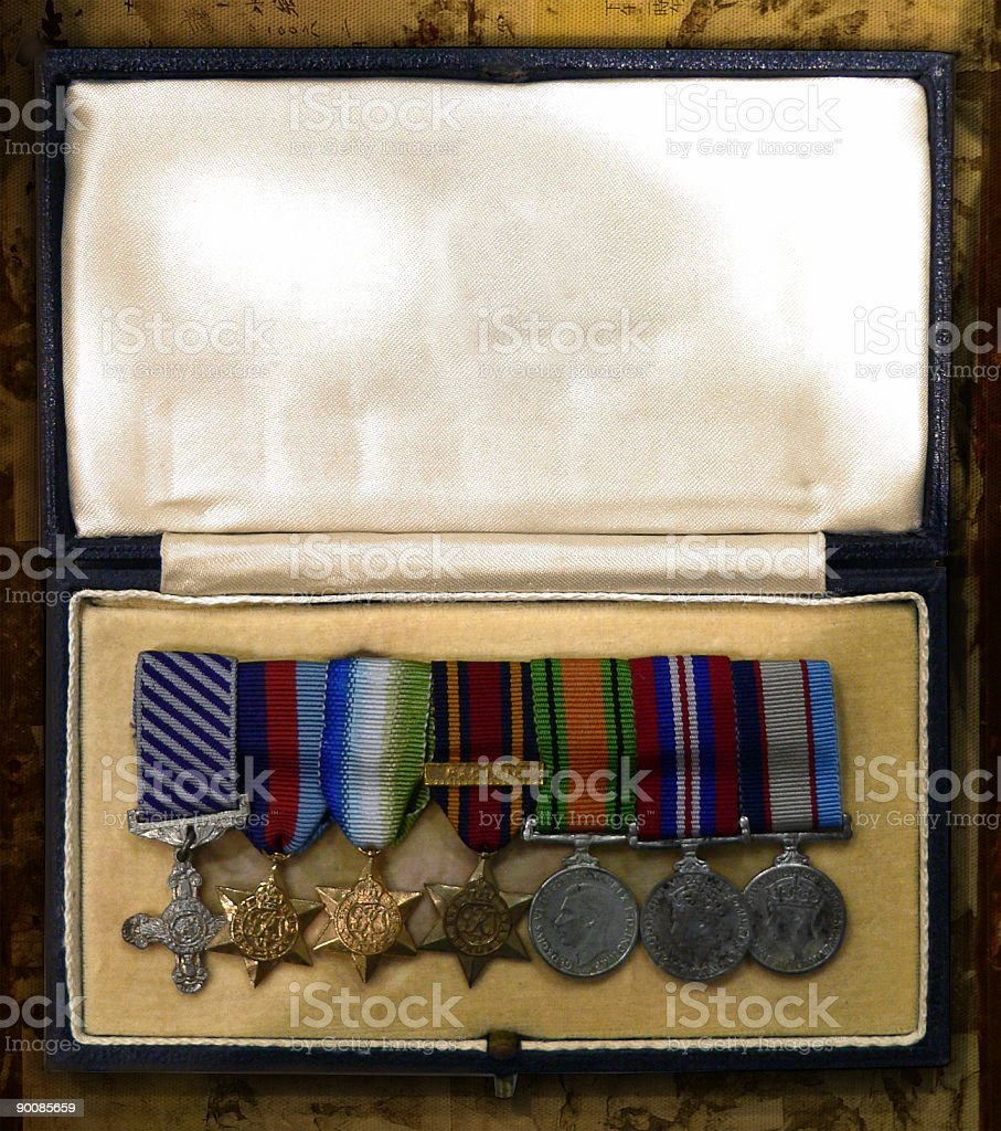 World War Two Medals in box on old scratched background stock photo