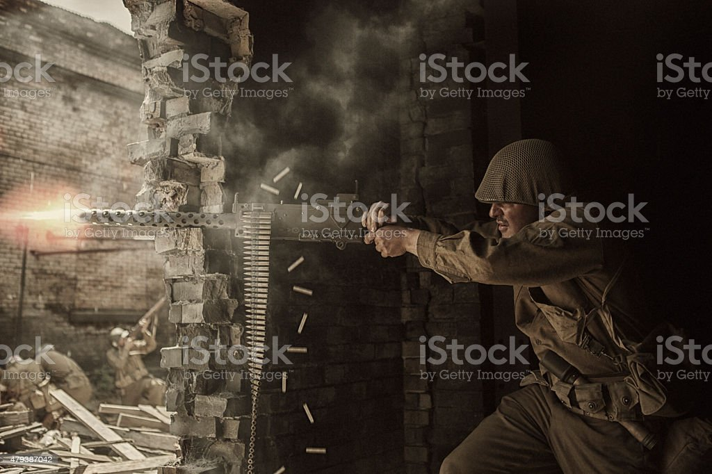 World War Two Soldier shooting Browning M1919 machine gun stock photo