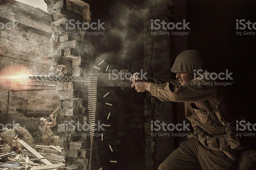 World War Two Soldier shooting Browning M1919 machine gun stock photo