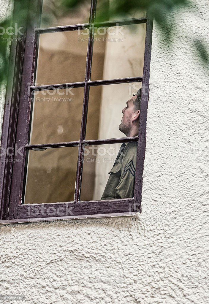 World War Two US Army Soldier Daydreaming At Window stock photo