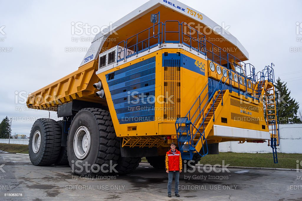 World's Largest Huge Truck BelAZ with man for scale stock photo
