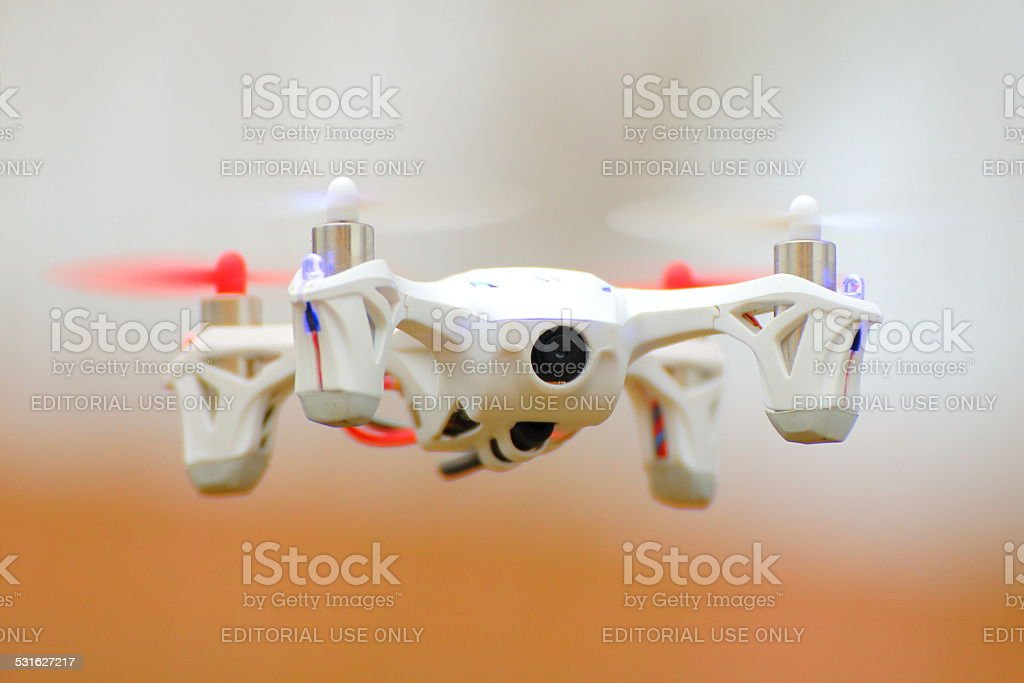 World's smallest FPV quadcopter drone flying stock photo