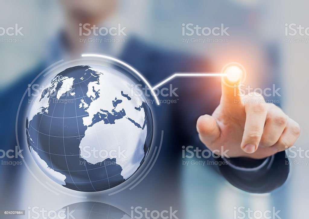 Worldwide business concept, 3D globe interface, businessman touching a button stock photo