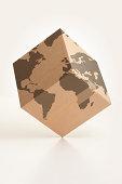 Worldwide logistics cardboard box and world map