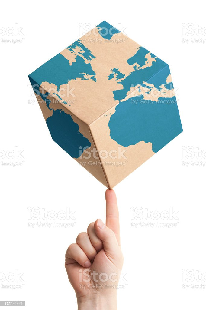 Worldwide parcel delivery cardboard box and world map stock photo