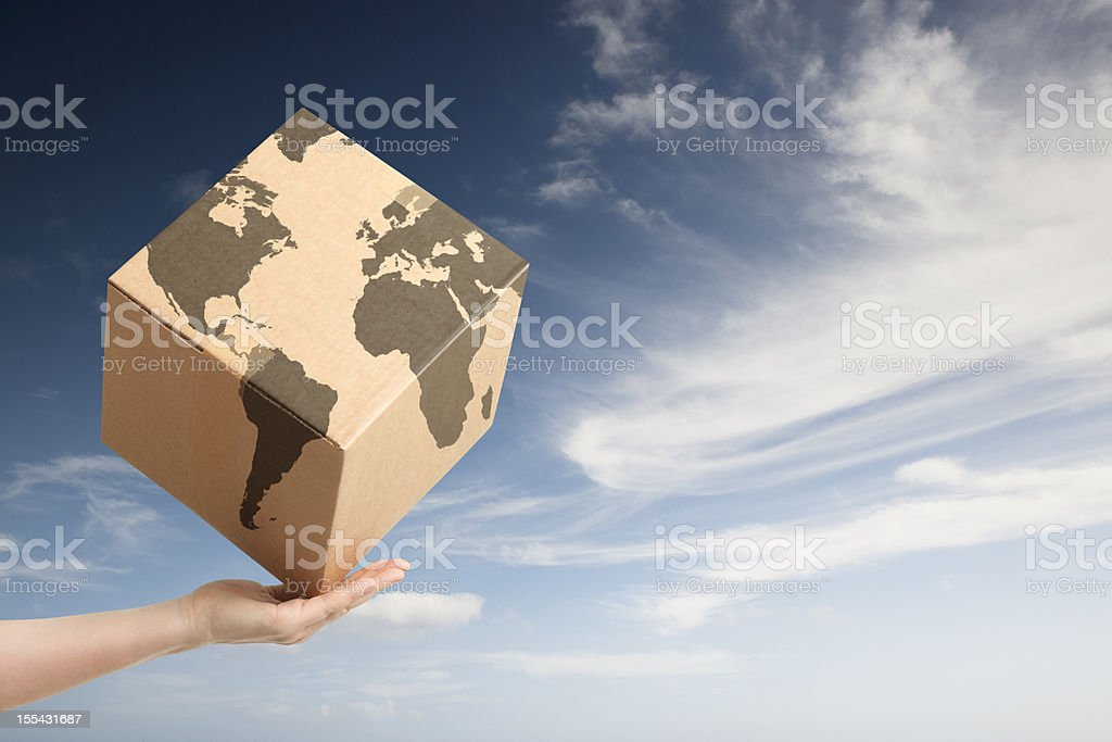 Worldwide trade cardboard box and world map royalty-free stock photo