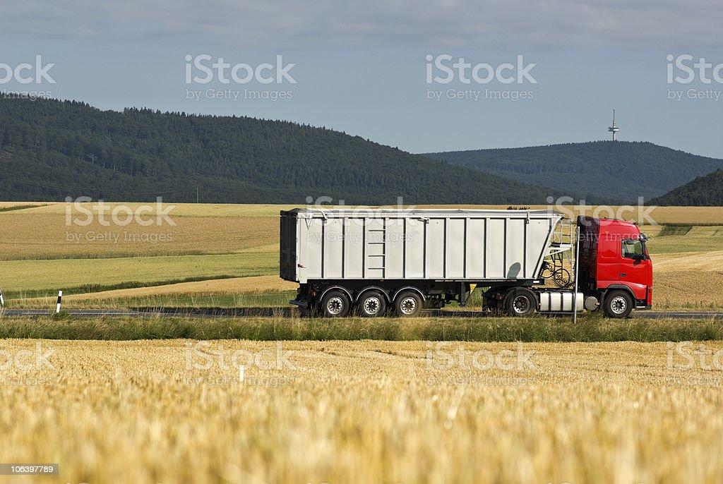 Worm's eye view of a dump truck in summer stock photo