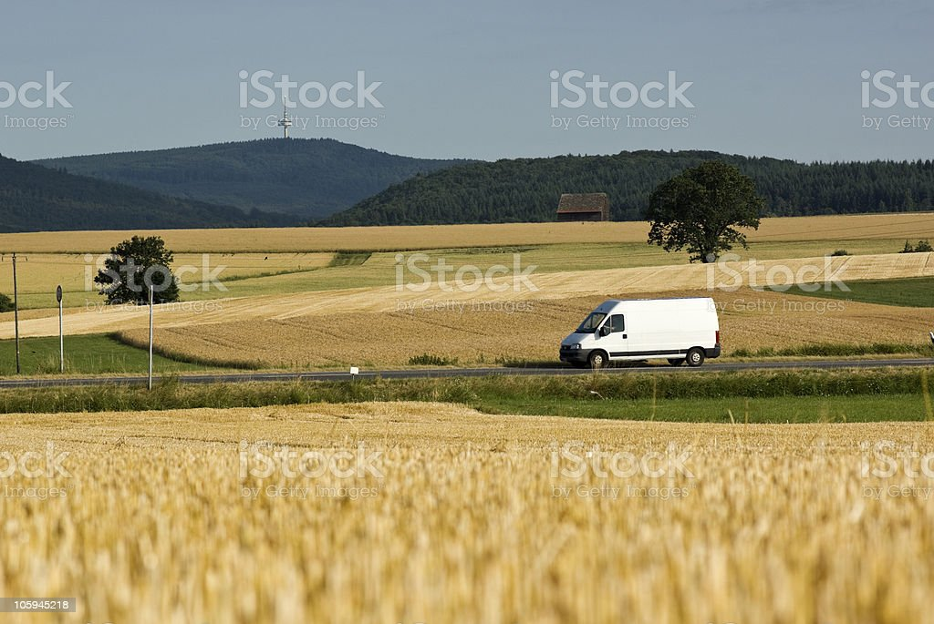 Worm's eye view of a white transporter in summer stock photo