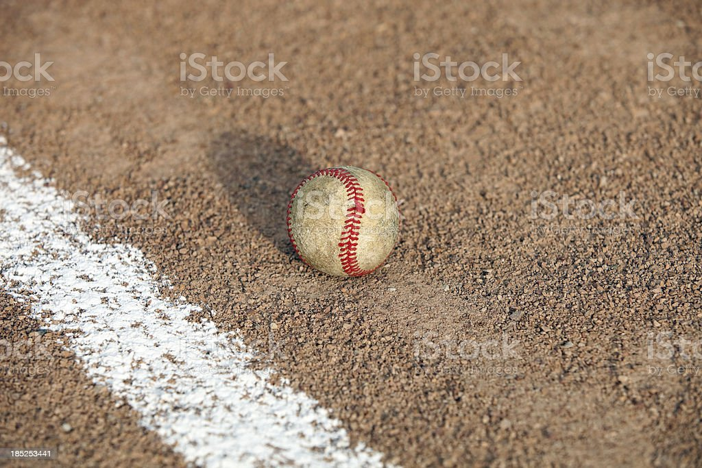 Worn Baseball inside or outside Foul Line stock photo