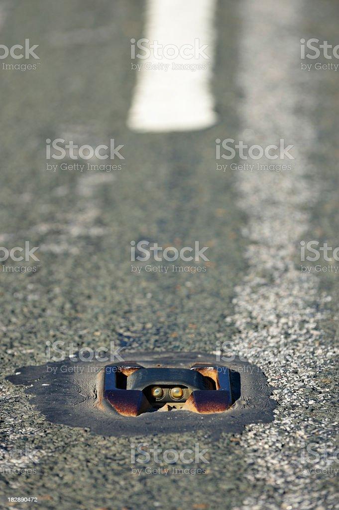 Worn British road marking known as cat's eyes royalty-free stock photo