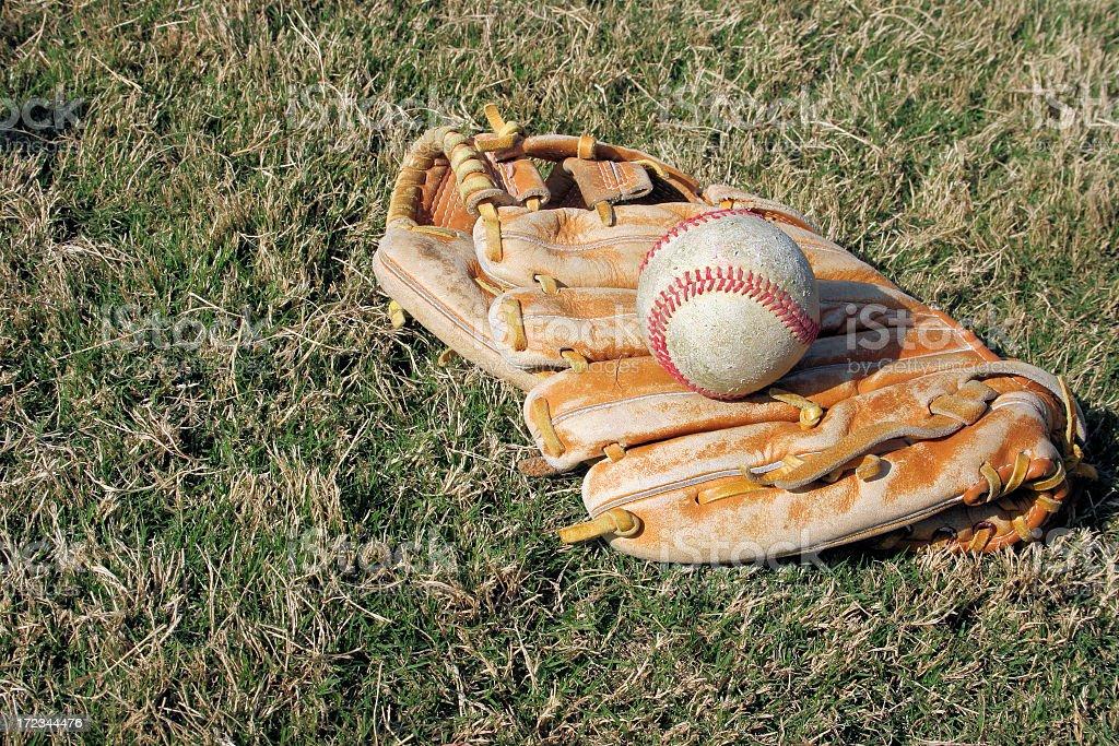Worn glove and baseball stock photo