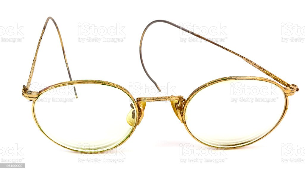 Worn Gold Wire Frame Glasses stock photo