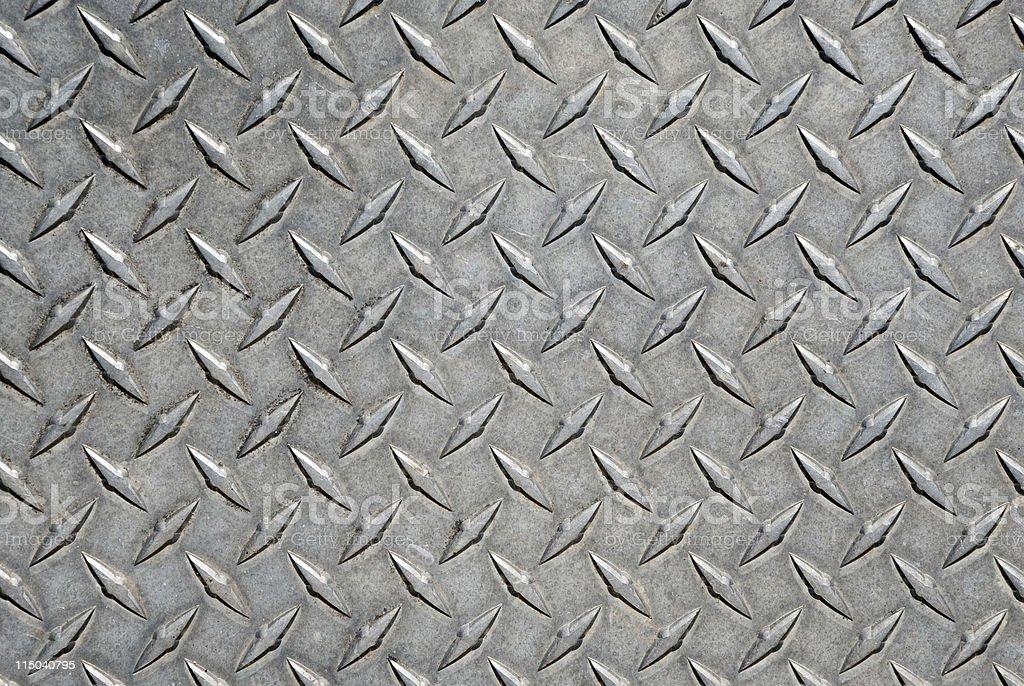 Worn Metal Diamond Tread Plate Pattern Background royalty-free stock photo