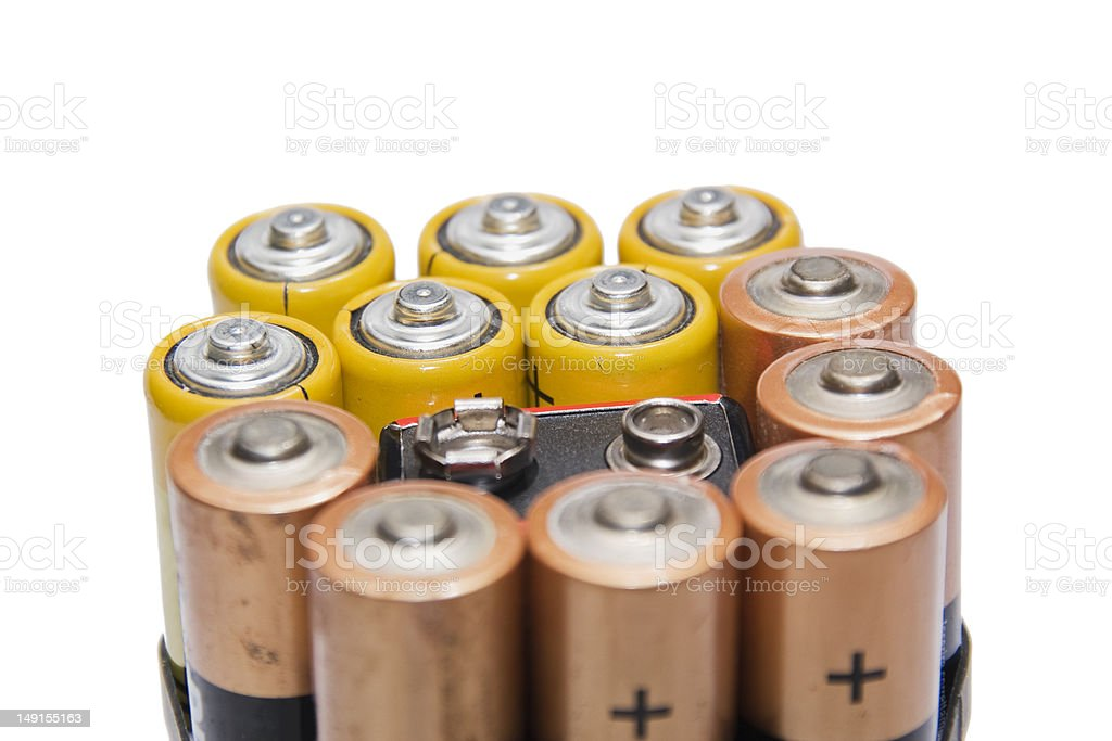 worn out batteries on white stock photo