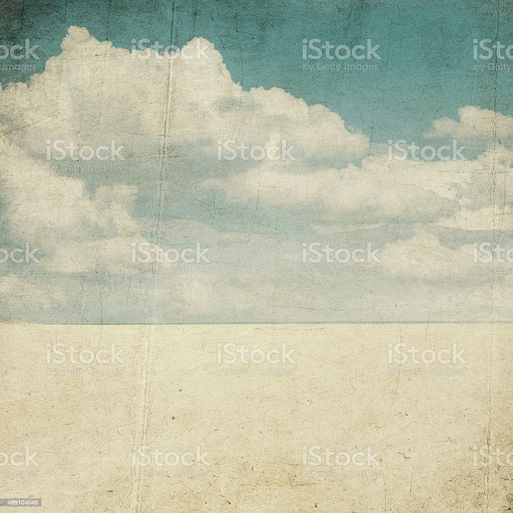 Worn out picture of the desert sand with the clouds above stock photo