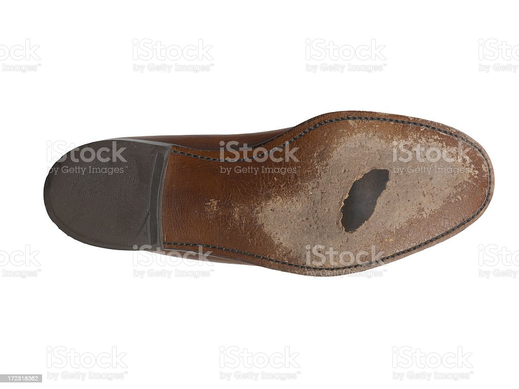Worn out Seoul of man's dress shoe with hole stock photo