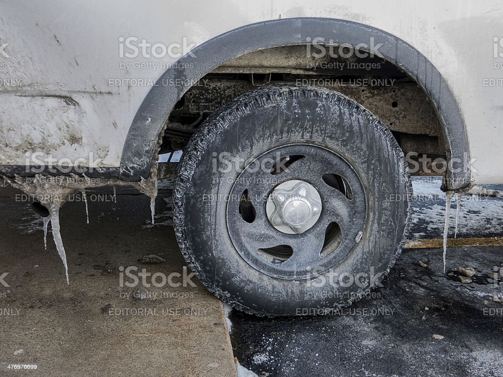 worn out tyre in cold winter stock photo