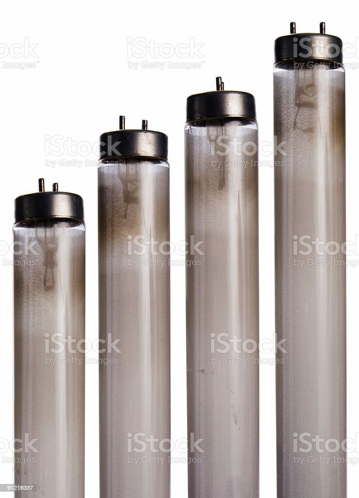 Worn out used fluorescent bulbs stock photo