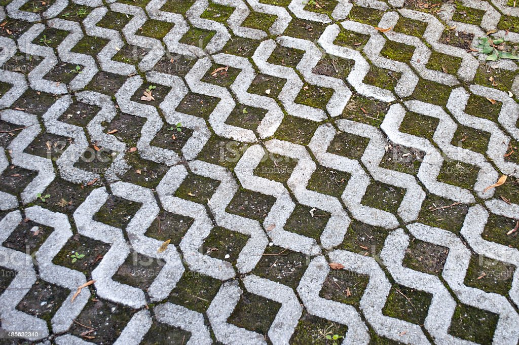 Worn Patterned Footpath Tiles royalty-free stock photo