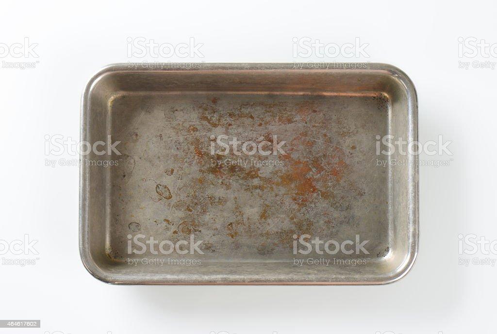 Worn roasting tin stock photo
