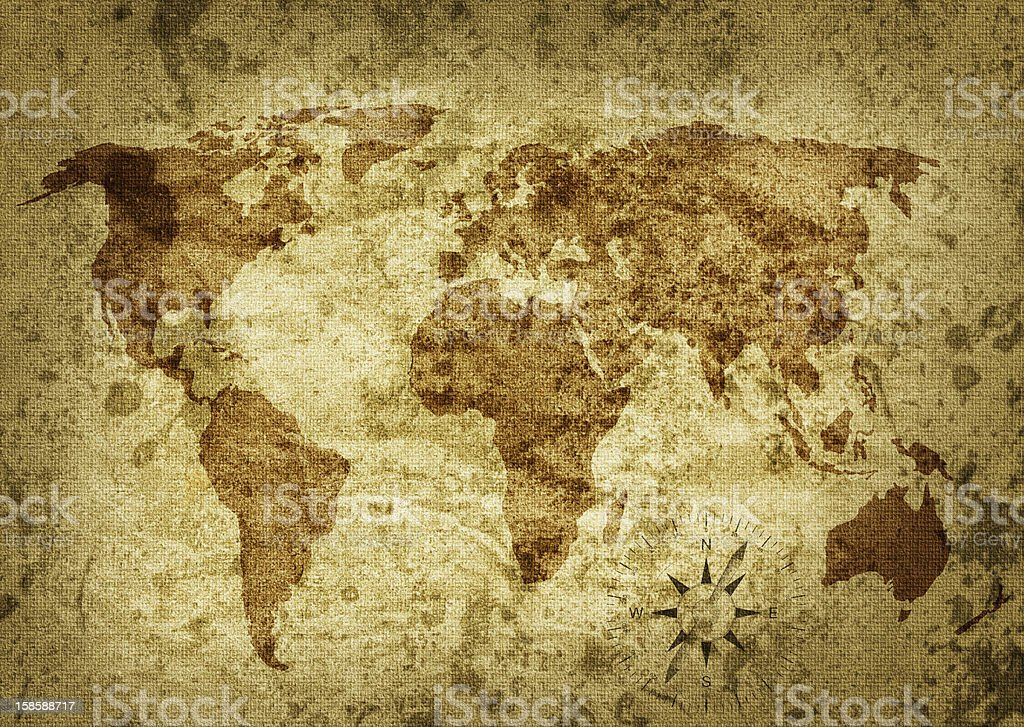 A worn, sepia toned world map covered in stains stock photo