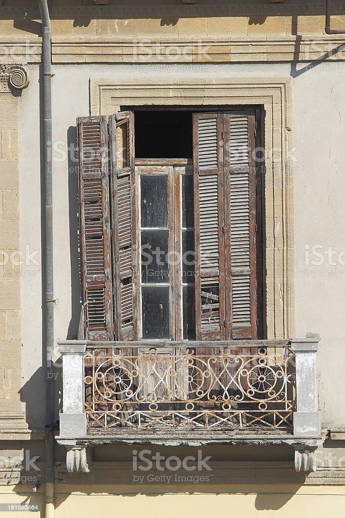worn wooden grunge  weathered window shutter and balcony Nicosia Cyprus royalty-free stock photo