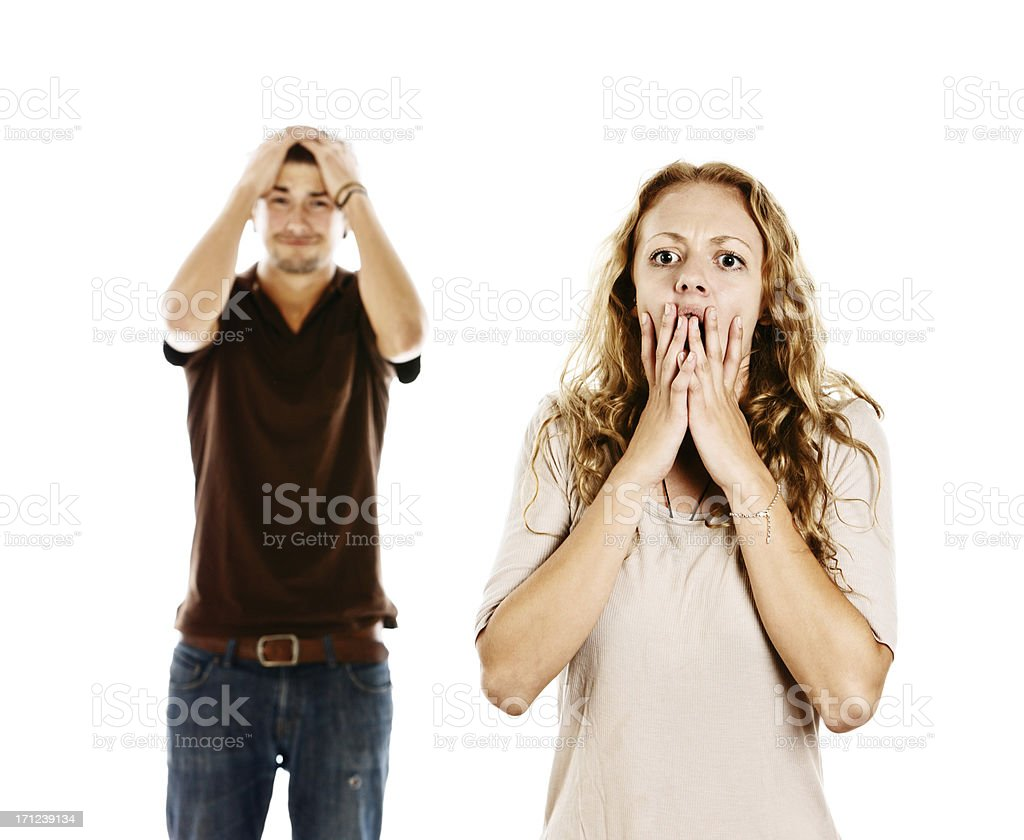 Worried and frantic young couple see something horrifying stock photo