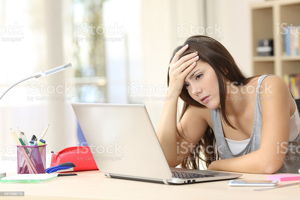 Worried and sad student online stock photo