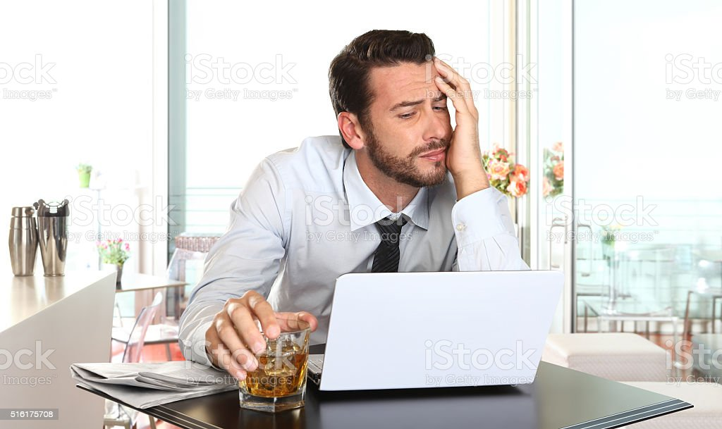 worried and tired businessman in crisis working on computer stock photo