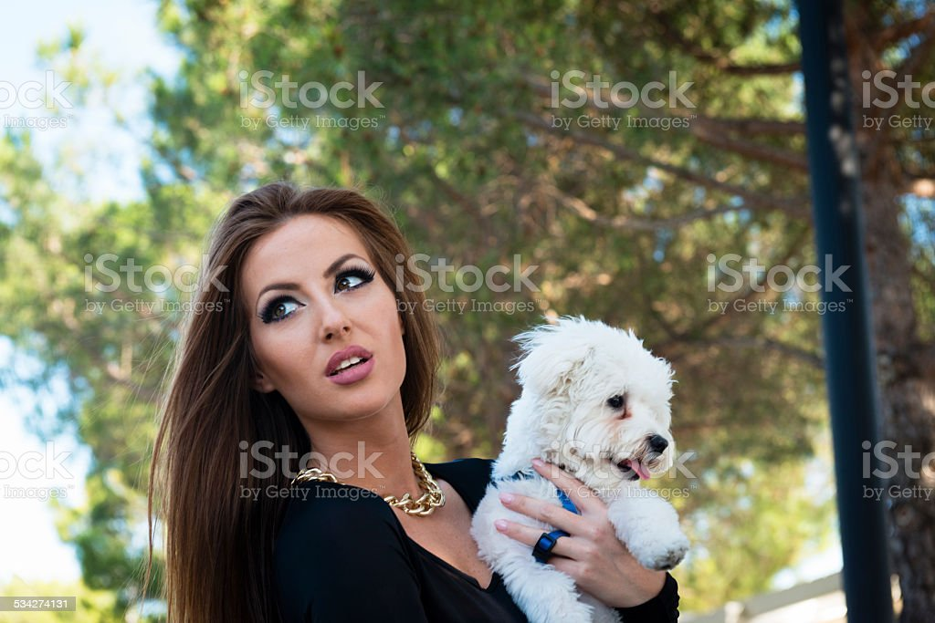 Worried Attractive Woman with Maltese Poodle, Portorose, Europe stock photo