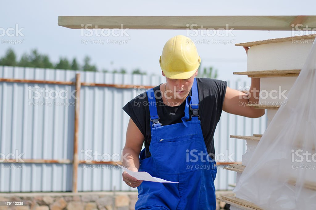 Worried builder on site with a document stock photo