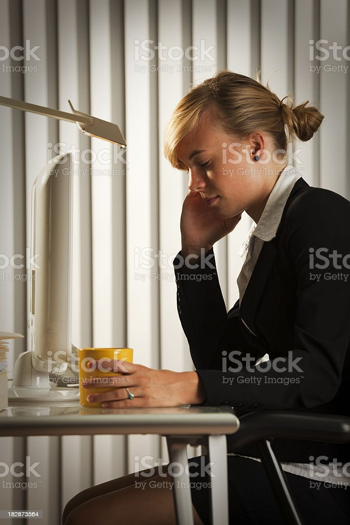 Worried Business Woman Working Late in the Evening royalty-free stock photo