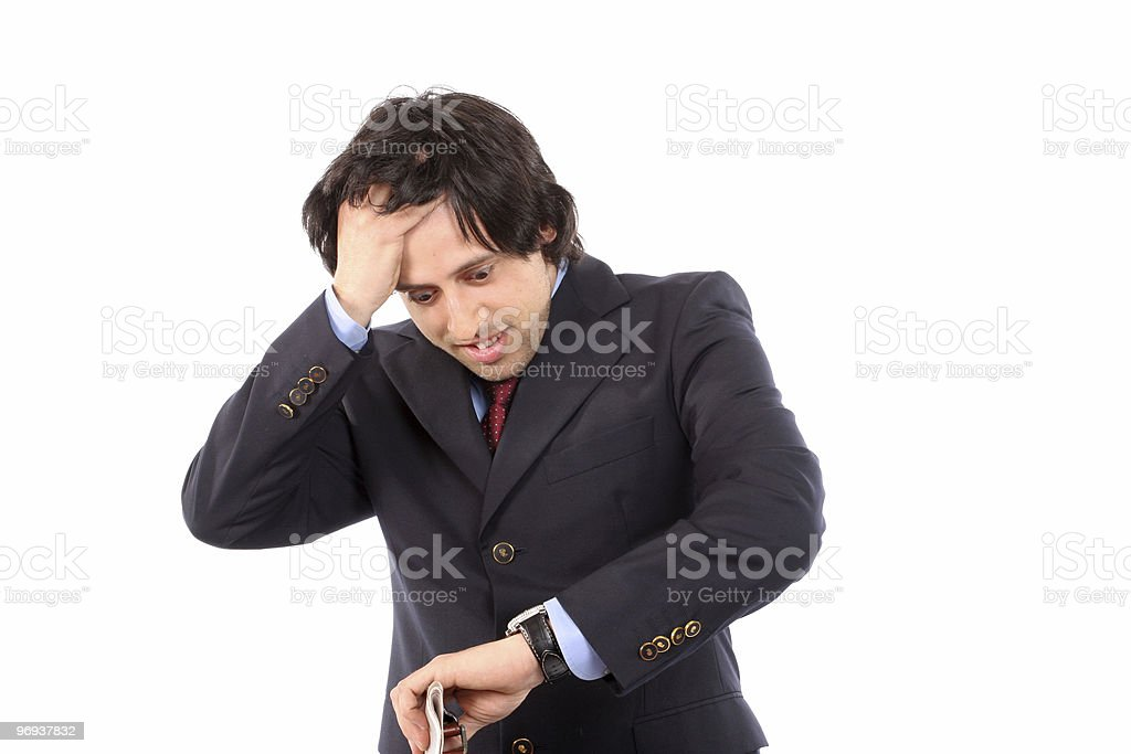 worried businessman consulting his watch stock photo