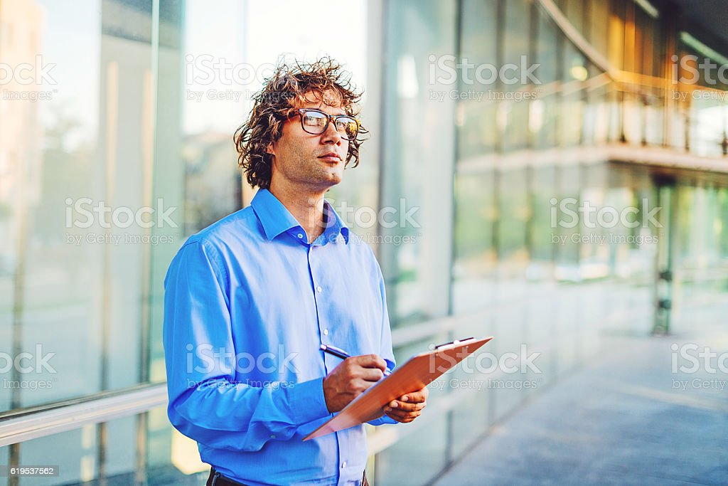 Worried businessman decides to sign contract or not stock photo