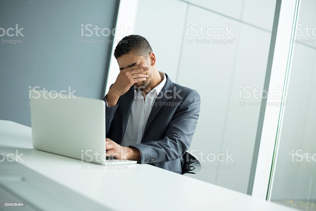 Worried businessman. Feeling exhausted. stock photo