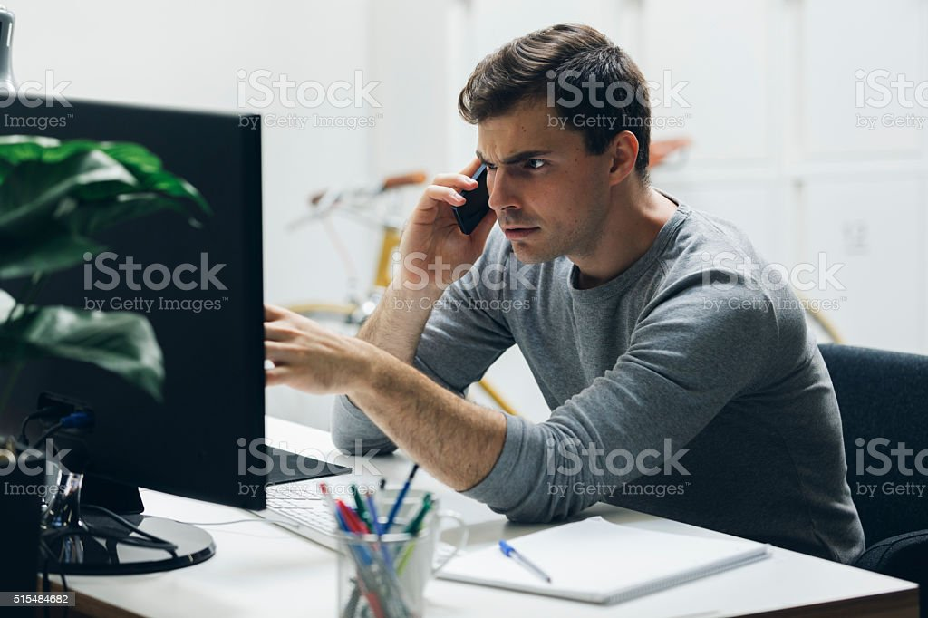 Worried businessman in office. stock photo
