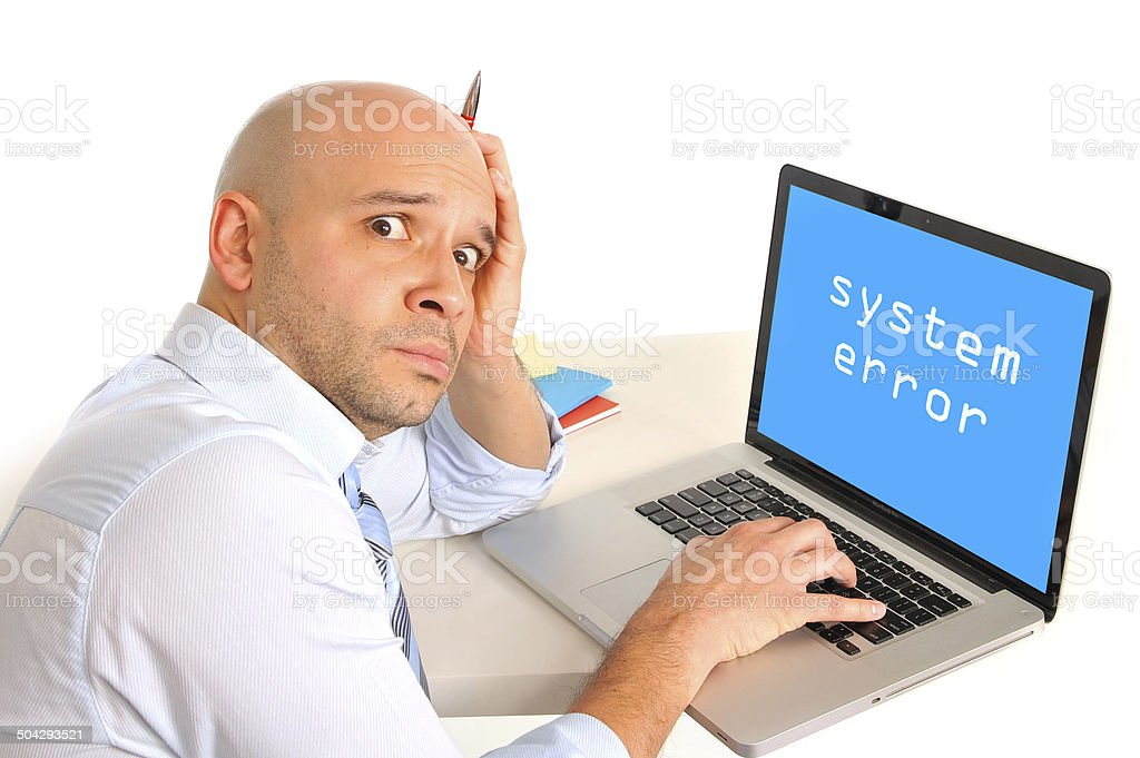worried businessman in stress on laptop at system error stock photo