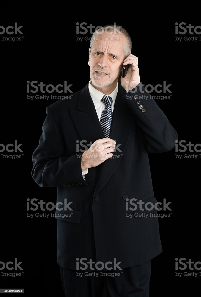 Worried Businessman on Phone stock photo