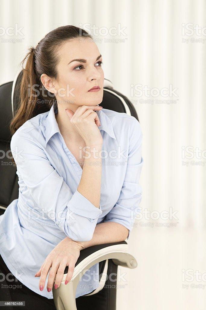 Worried businesswoman looking away stock photo