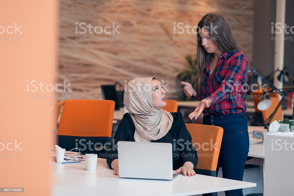 Worried businesswoman receiving a notification from a colleague stock photo