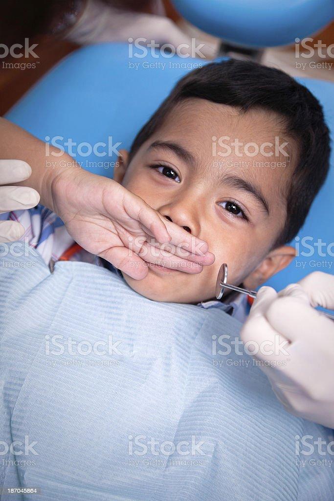 Worried child refusing dental treatment royalty-free stock photo