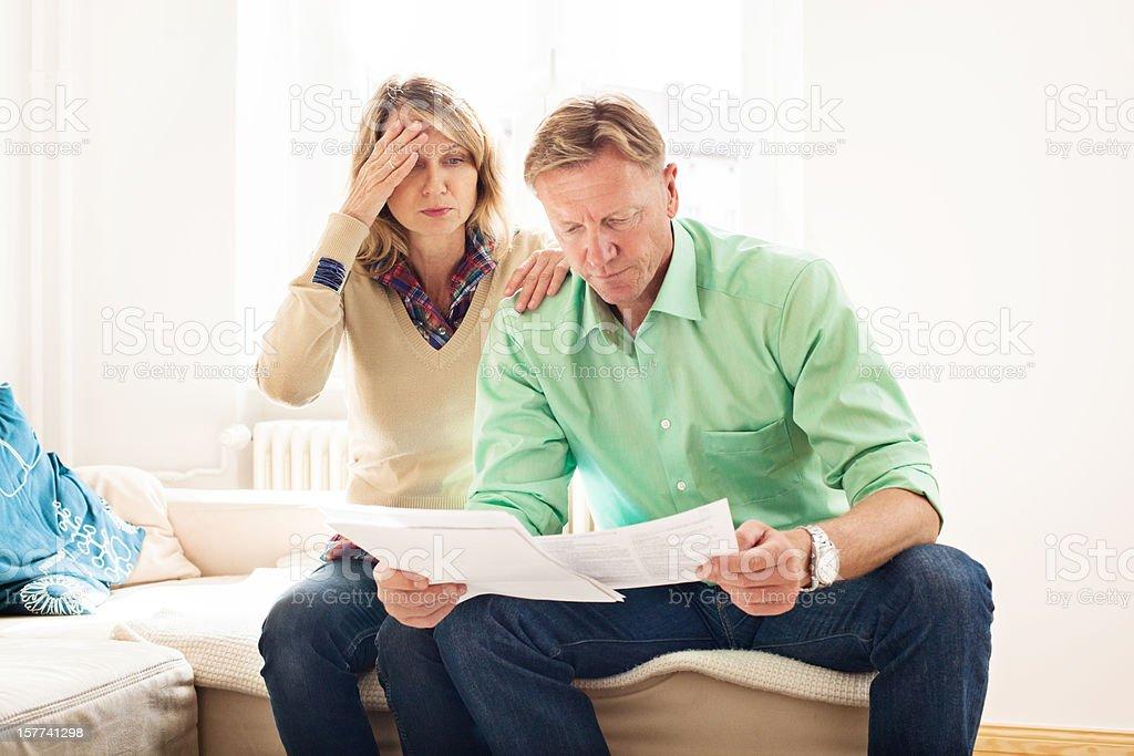 Worried couple going through their finances stock photo