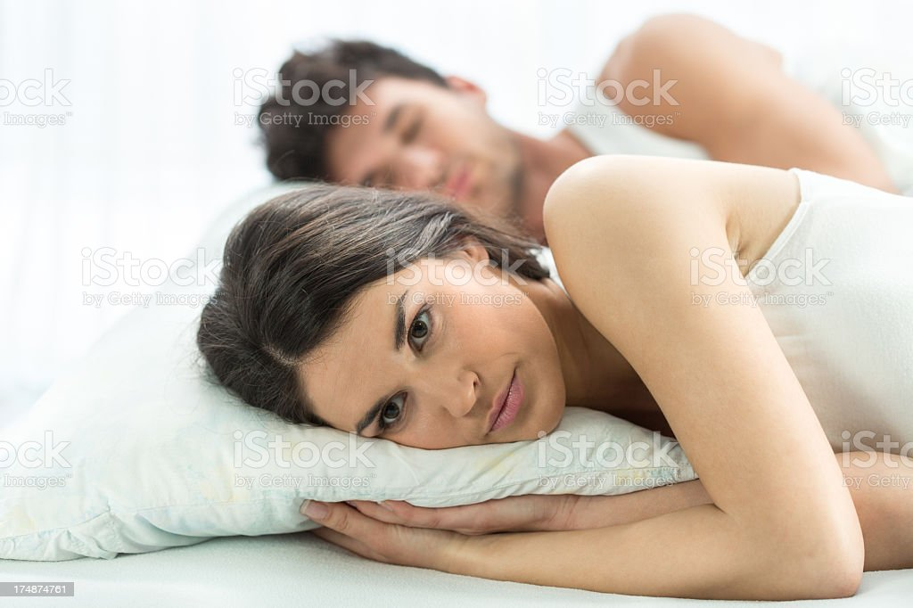 Worried couple in bed royalty-free stock photo