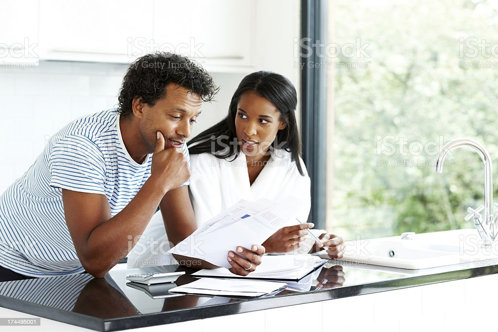 Worried couple working on personal finances stock photo