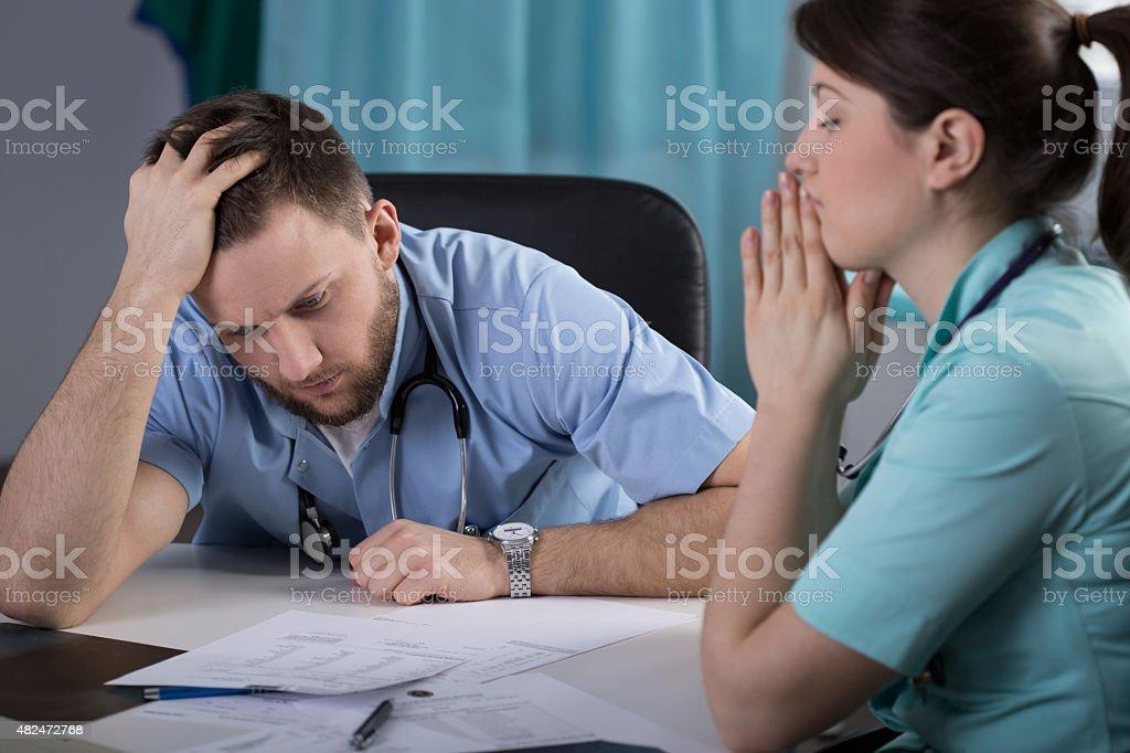 Worried doctors in office stock photo