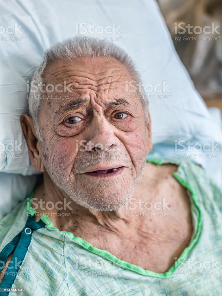 Worried Elderly Man Hospital Patient Asking Serious Questions stock photo