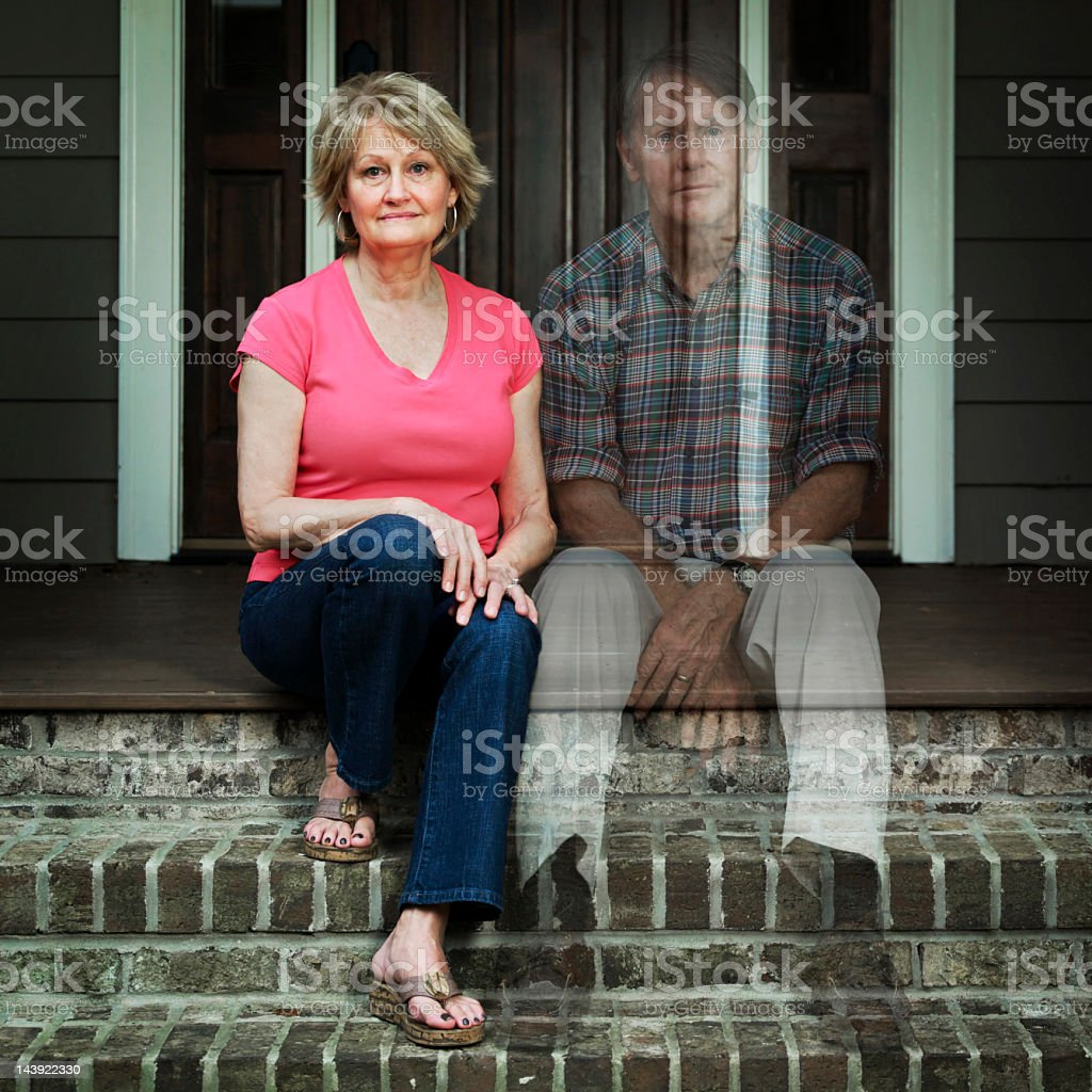 Worried Elderly Man Sitting Outside The House stock photo