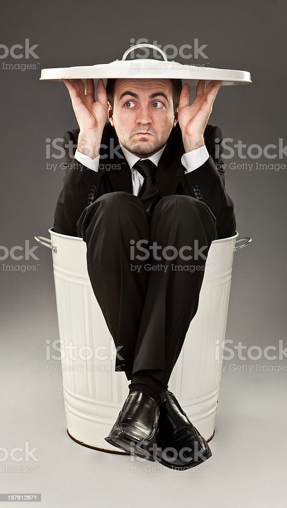 worried failure business man hide in trash can royalty-free stock photo