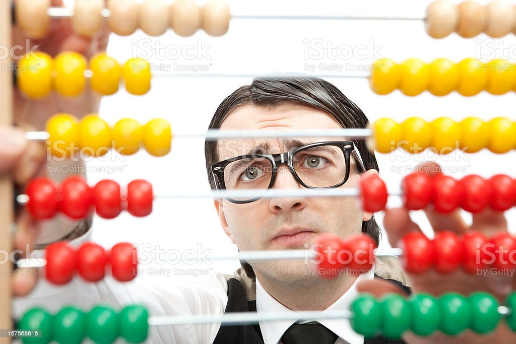 worried fool man calculates with an abacus royalty-free stock photo