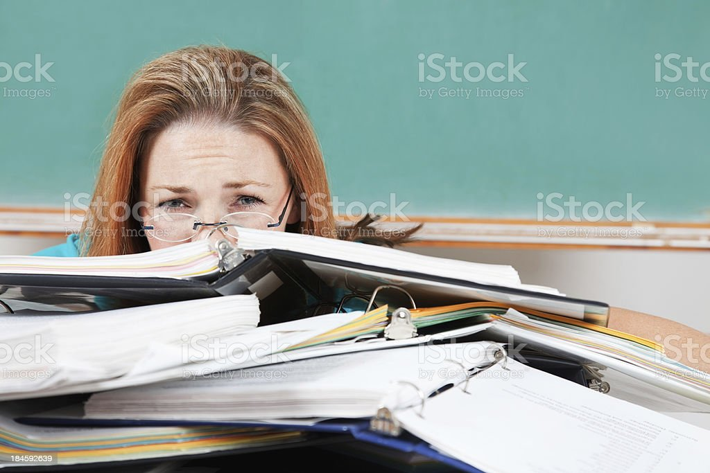 Worried Graduate Student Burried in Class Binders royalty-free stock photo
